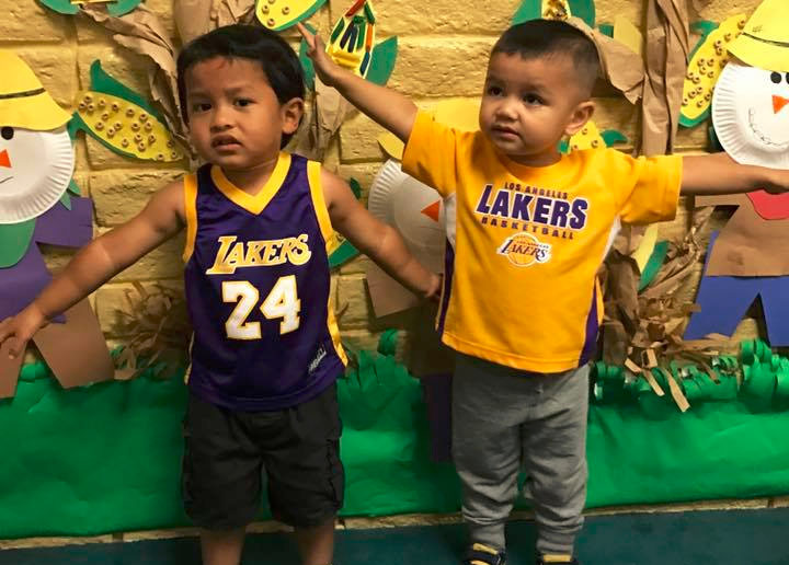 Two young little kid boys wearing Lakers jersey at A Preschool & daycare Serving Armona, CA
