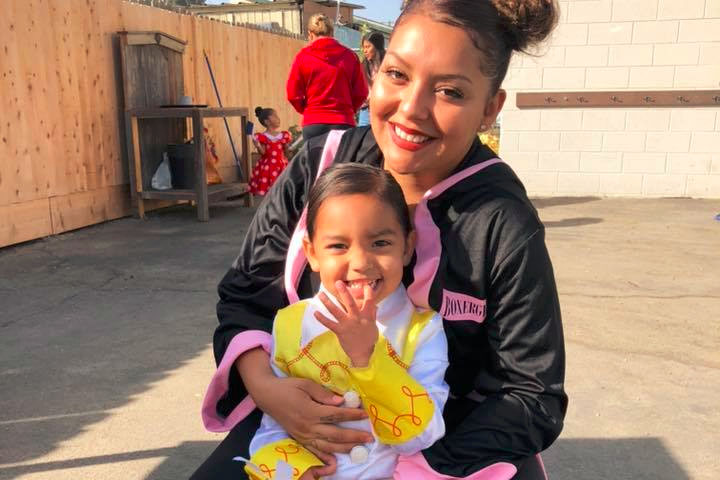 Happy mom ad her cute little girl both wearing martial arts costume at A Preschool & daycare Serving Armona, CA