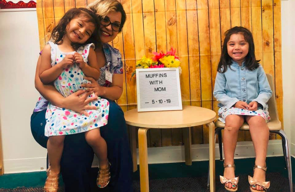 Happy mom and her two little young girls at A Preschool & daycare Serving Armona, CA