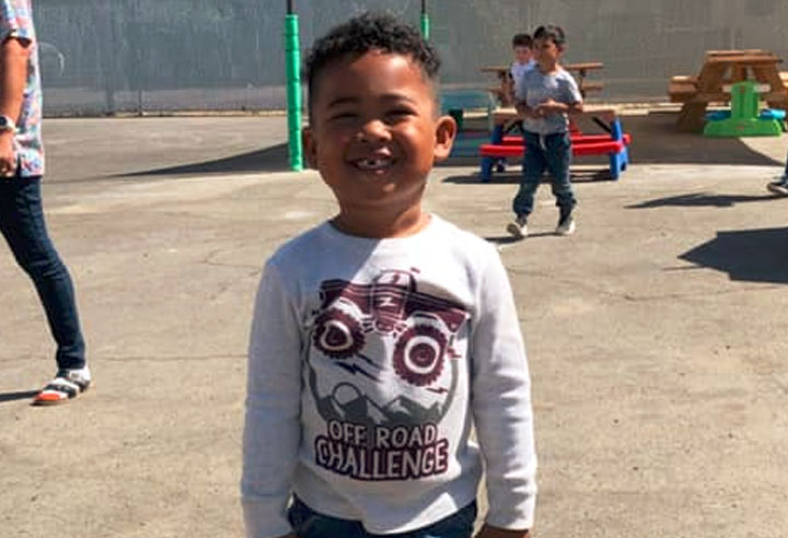 African american toddler boy smiling at A Preschool & daycare Serving Armona, CA
